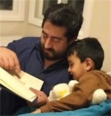 Dad reading to a child