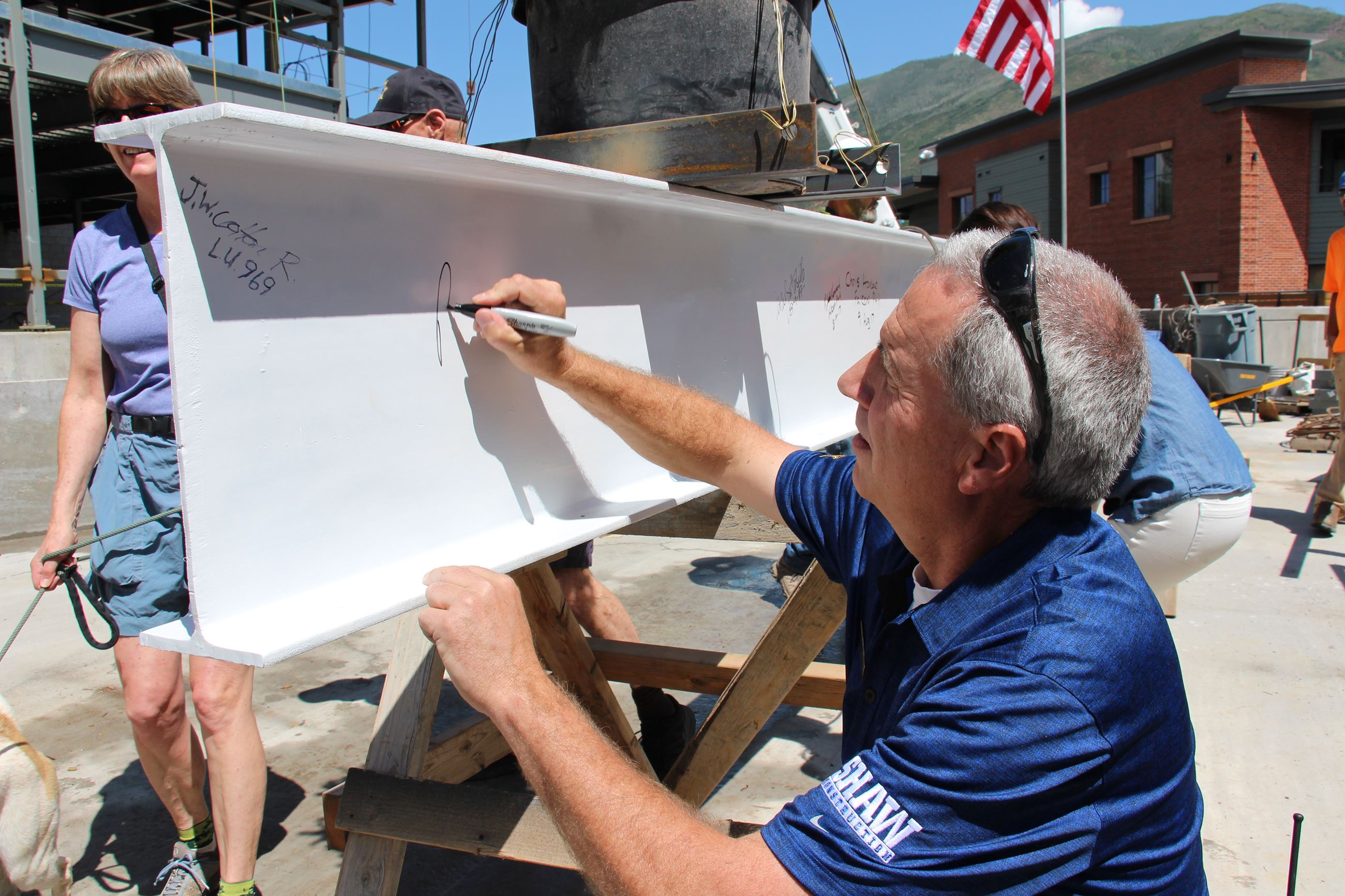 Chief Pryor signing final beam